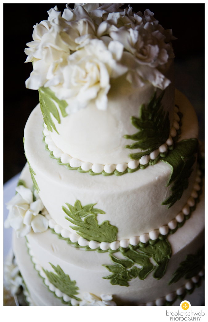 ivory cake with green leaves