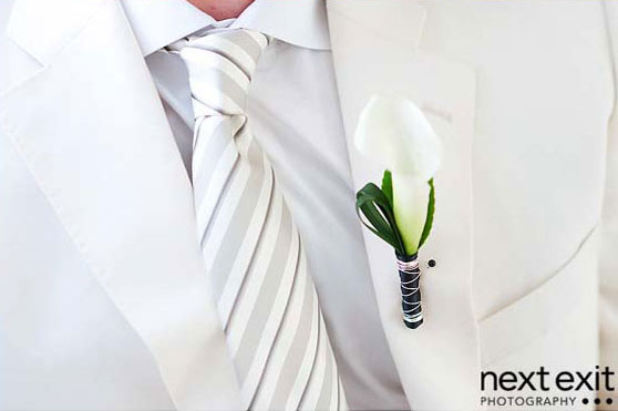 boutonniere and white tie groom