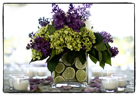 purple centerpiece with limes
