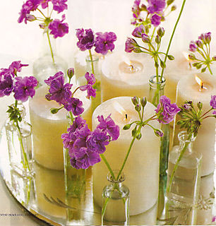 purple floral and candle centerpiece