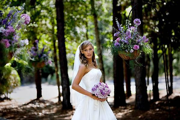 bride with purple bouquet