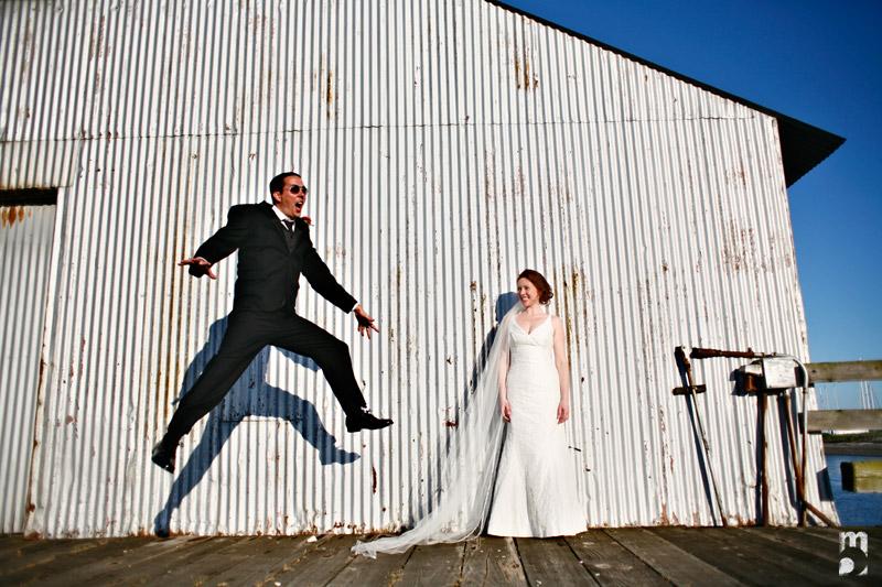groom jumping portrait