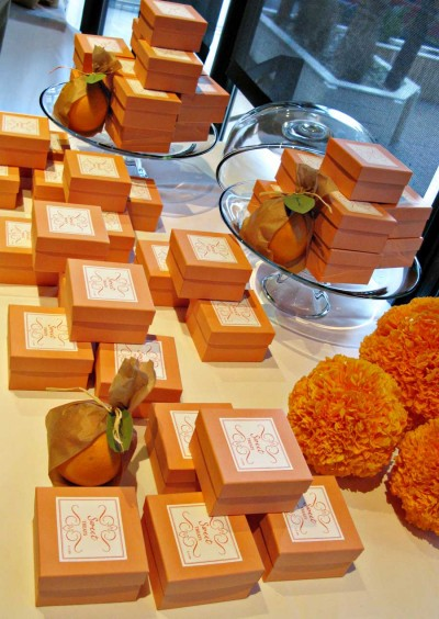 favor-box-table-using-cake-trays-and-tissue-paper-pomanders-as-props
