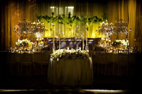 lush-yellow-and-green-estate-table-centerpieces-chandeliers