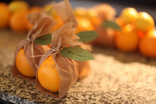 orange-wrapped-in-parchment-paper-tied-with-raffia-and-goccoed-leaf