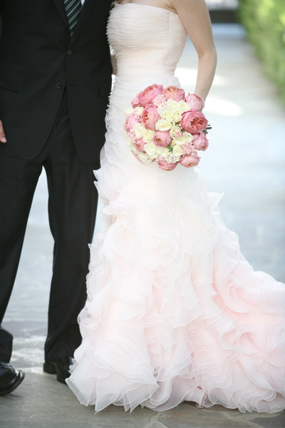 pink wedding gown and bouquet