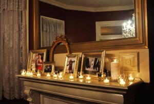 mantle with framed photos