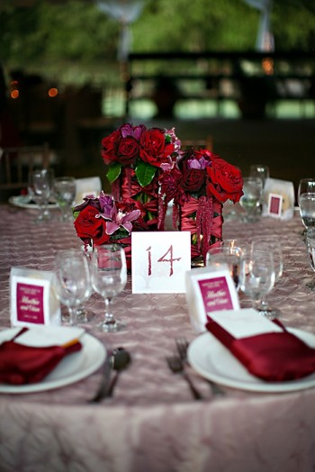 cranberry-purple-red-raspberry-centerpiece-ribbon-wrapped-glass