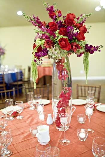 tall purple and red rose centerpiece