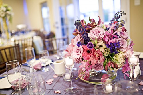 purple and pink centerpiece with purple linens