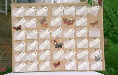 vellum-escort-card-envelopes-corkboard