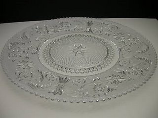 I found this vintage 16\u2033 torte plate in a pattern aptly named Princess Feather. At 16\u2033 it will show about an inch all the way around the 14\u2033 cake board. & A Plate to Cut a Cake On* - Elizabeth Anne Designs: The Wedding Blog