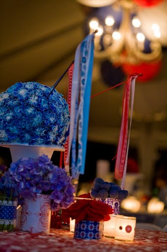 blue and red centerpieces with pomanders and covered tin can centerpieces