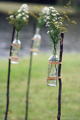 glass-jars-tied-to-sticks