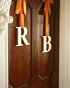 monogram-letters-on-church-door-hanging-from-ribbon