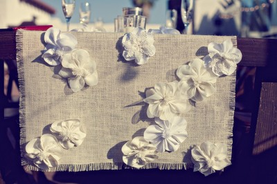 handmade table runner with white fabric flowers