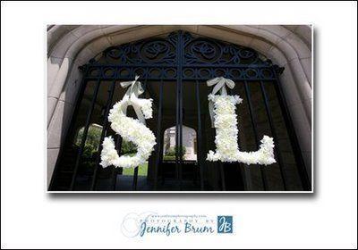 white-flower-monogram-letters-on-church-gates