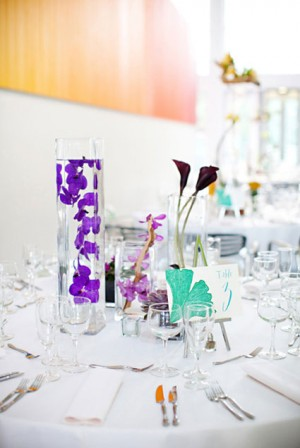modern-contemporary-purple-centerpieces-submerged-flowers