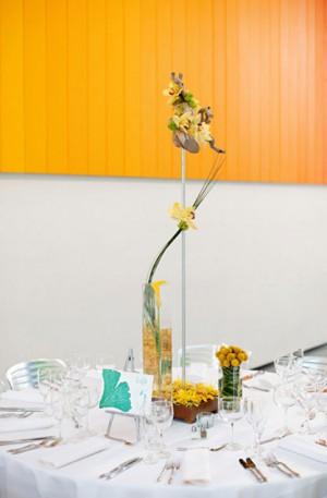 modern-orange-yellow-centerpieces-varying-heights