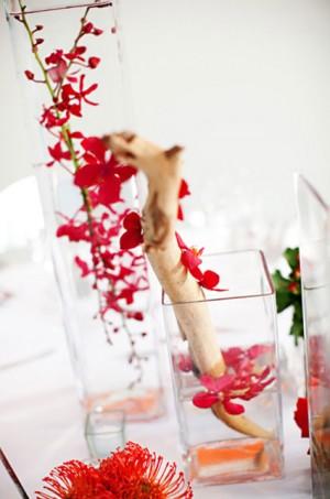 modern-red-branch-centerpiece-submerged-flowers