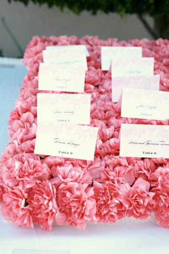 pink-carnation-escort-card-bed