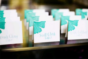 tropical-teal-theme-escort-cards-whimsical-calligraphy