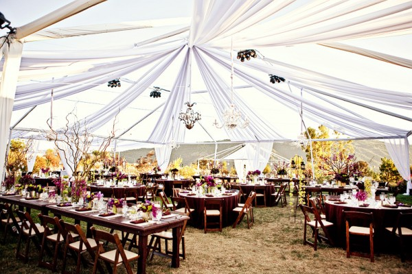 Chandeliers Hanging From Tent Outdoor Wedding Reception