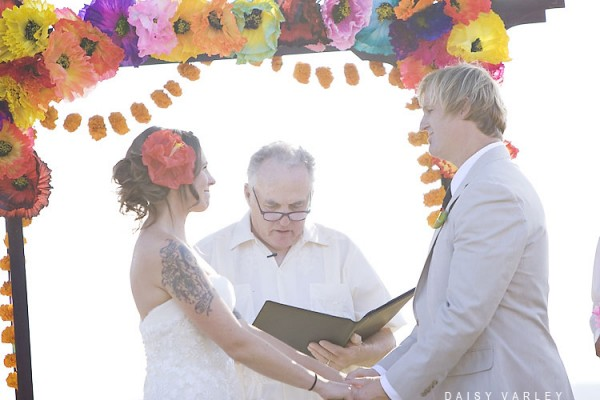 Wedding Under Colorful Tissue Paper Arch