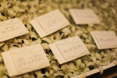 calligraphy-escort-cards-on-a-bed-of-orchids