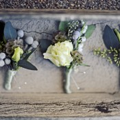 gray-and-green-boutonnieres-with-berries