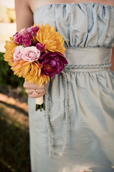 ice-blue-bridesmaids-dresses-fuschia-yellow-bouquets