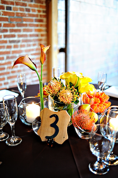 orange-centerpieces-brown-linens