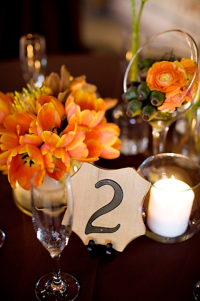 Yellow orange and green wedding at the marvimon house for Orange centerpieces for tables