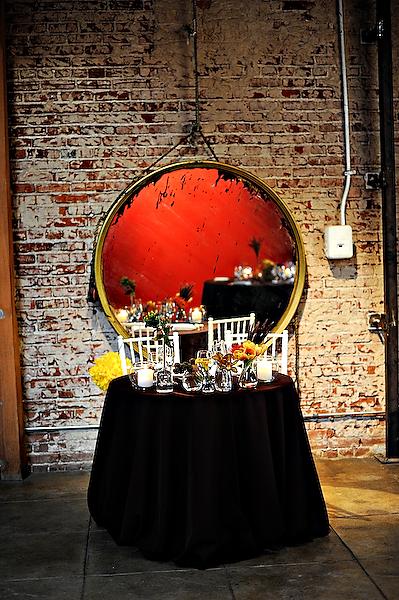 sweetheart-table-wedding-yellow-orange-centerpieces