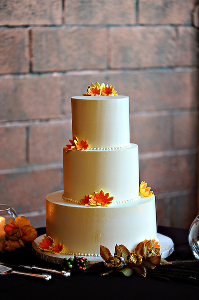 white-cake-with-orange-flowers