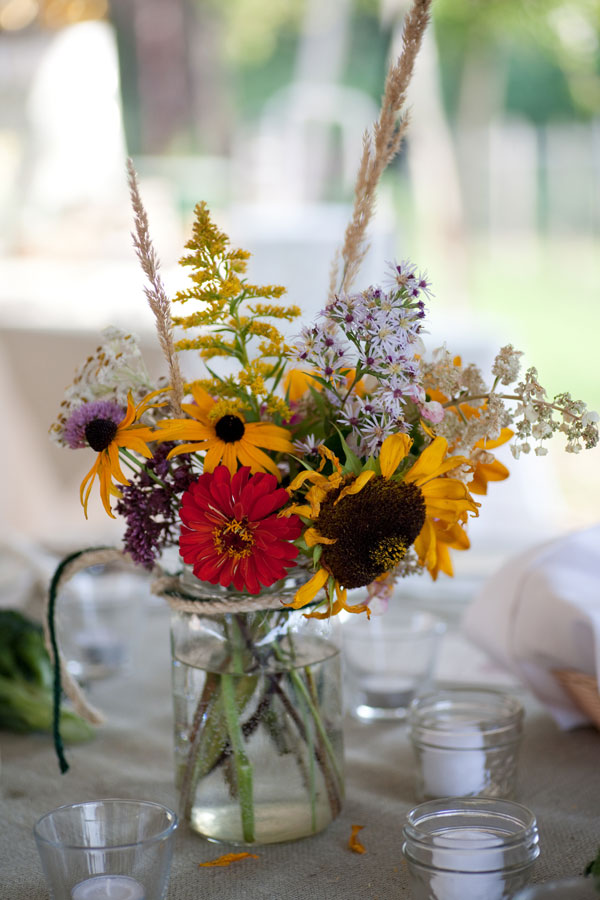 Wildflower centerpieces mason jars yellow red purple