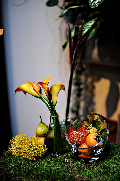 yellow-and-orange-centerpieces-on-moss