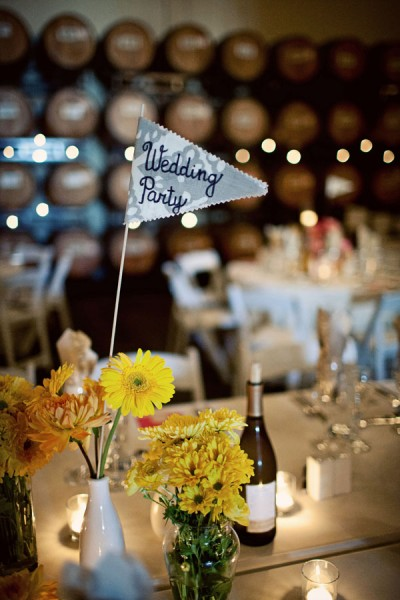 yellow-diy-wedding-centerpieces-fabric-flag-table-numbers