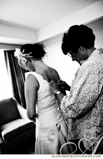 bride-putting-on-gown