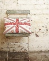 pink-red-pillow-on-rustic-chair