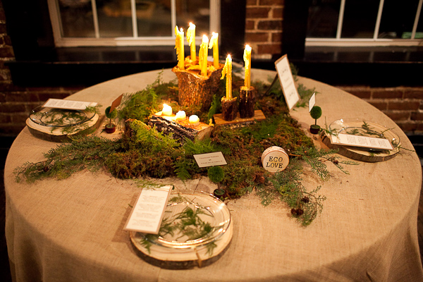 Rustic moss and wood wedding centerpiece tablescape