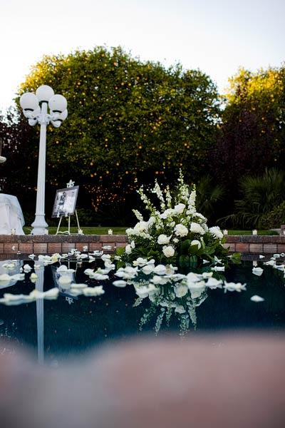 Pool Wedding Ideas 17 backyard wedding string lights over pool Flowers Floating In Pool Backyard Wedding Ideas