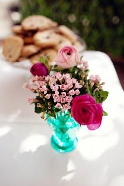 pink-arrangements-in-blue-glass-vase