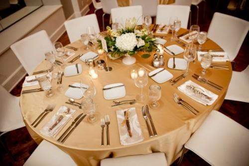 Gold linens wedding gold linens White Centerpieces Gold Linens 500x333