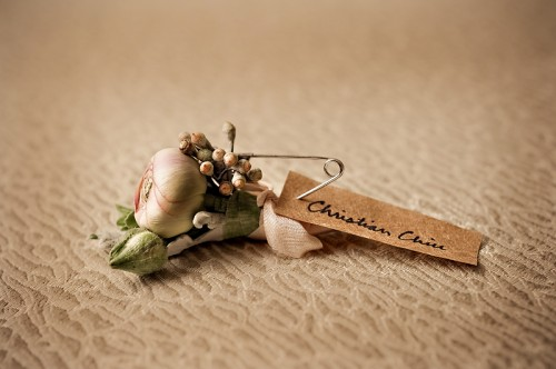 Pink and Green Ranunculus Boutonniere
