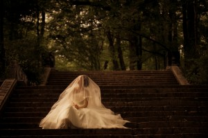 Bride Sitting on Steps
