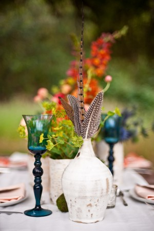Gypsy-Wedding-Ideas-Blue-Goblets-and-Feather-Centerpieces