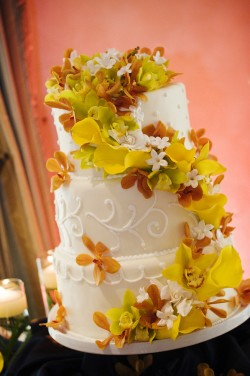 Wedding-Cake-with-Yellow-and-Orange-Orchids
