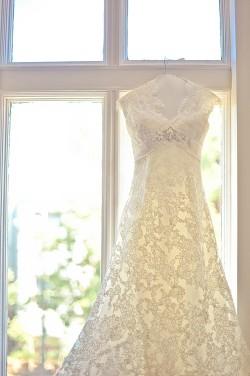 Hanging-Wedding-Gown-in-Window
