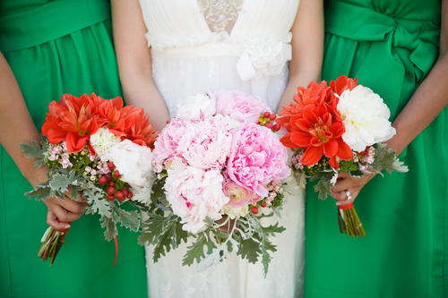 pink and red bouquets with green bridesmaids dresses